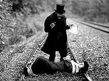 Damsel in distress tied to railroad track